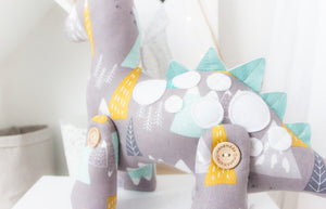 RubyBabyDesigns Keepsake Collective Duke the Dinosaur in mountain print. Jointed legs of wooden handmade engraved and faux leather spines, finished off with hand cut felt applique spots. Mountain print with grey, mustard, white, aqua and navy within the print. Handmade in Melbourne. Created with environmentally friendly PET fill.