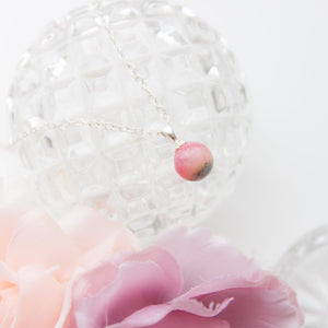 RubyBabyDesigns Keepsake Collective Primrose Pearl Pendant, created using special inclusions such as preserved breastmilk, preserved flowers, locks of hair, cremation ashes, pieces of fabrics and clothing. Handmade in Melbourne.