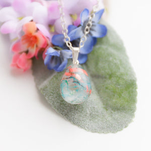 RubyBabyDesigns Keepsake Collective Memories in Threads Resin Teardrop pendant using inclusions such as loved ones clothing, fabrics, cremation ashes, preserved breastmilk, preserved flowers, locks of hair etc, handmade, made in melbourne, hand crafted.