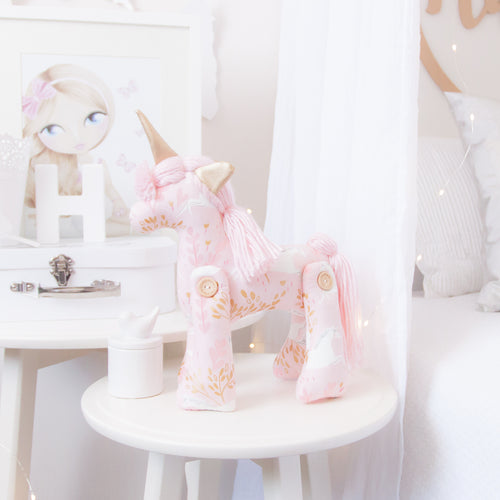 RubyBabyDesigns heirloom cloth doll, unity the unicorn, unicorn, pegasus, horse, faux leather, rag doll, cloth decor, heirloom, keepsake, handmade, made in melbourne, wooden buttons, buttons, leaves, unicorns, pink, gold, wool, metallic, white, light pink