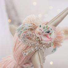 Load image into Gallery viewer, RubyBabyDesigns Keepsake Collective Luxe Heirloom Cloth Unity the Unicorn, created with vintage cross stitch fabric on a natural base. Paired with nude metallic mane and tail, she has a lovely full tutu skirt with lace edging. Finished off with gold faux leather ears and horn with shabby flowers and rhinestone bow on her head. Created with handamde engraved wooden buttons, she is handmade and designed in Melbourne.