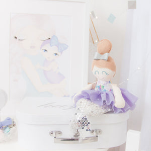 RubyBabyDesigns Keepsake Collective Mini Mee Ballerina Mermaid Heirloom Cloth Doll Decor, a scale printed body with lovely tones of lilacs, blues, aquas, greens, pinks, whites. Paired with a lilac tutu skirt and silver sequin mermaid tail. Ballerina bun sitting on top of her head in a wool blend toffee and a faux leather silver bow in her hair. Handmade and designed in Melbourne and environmentally friendly PET fill.
