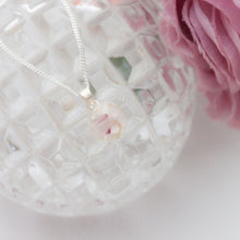 Load image into Gallery viewer, RubyBabyDesigns Keepsake Collective Primrose Pearl Pendant, created using special inclusions such as preserved breastmilk, preserved flowers, locks of hair, cremation ashes, pieces of fabrics and clothing. Handmade in Melbourne.