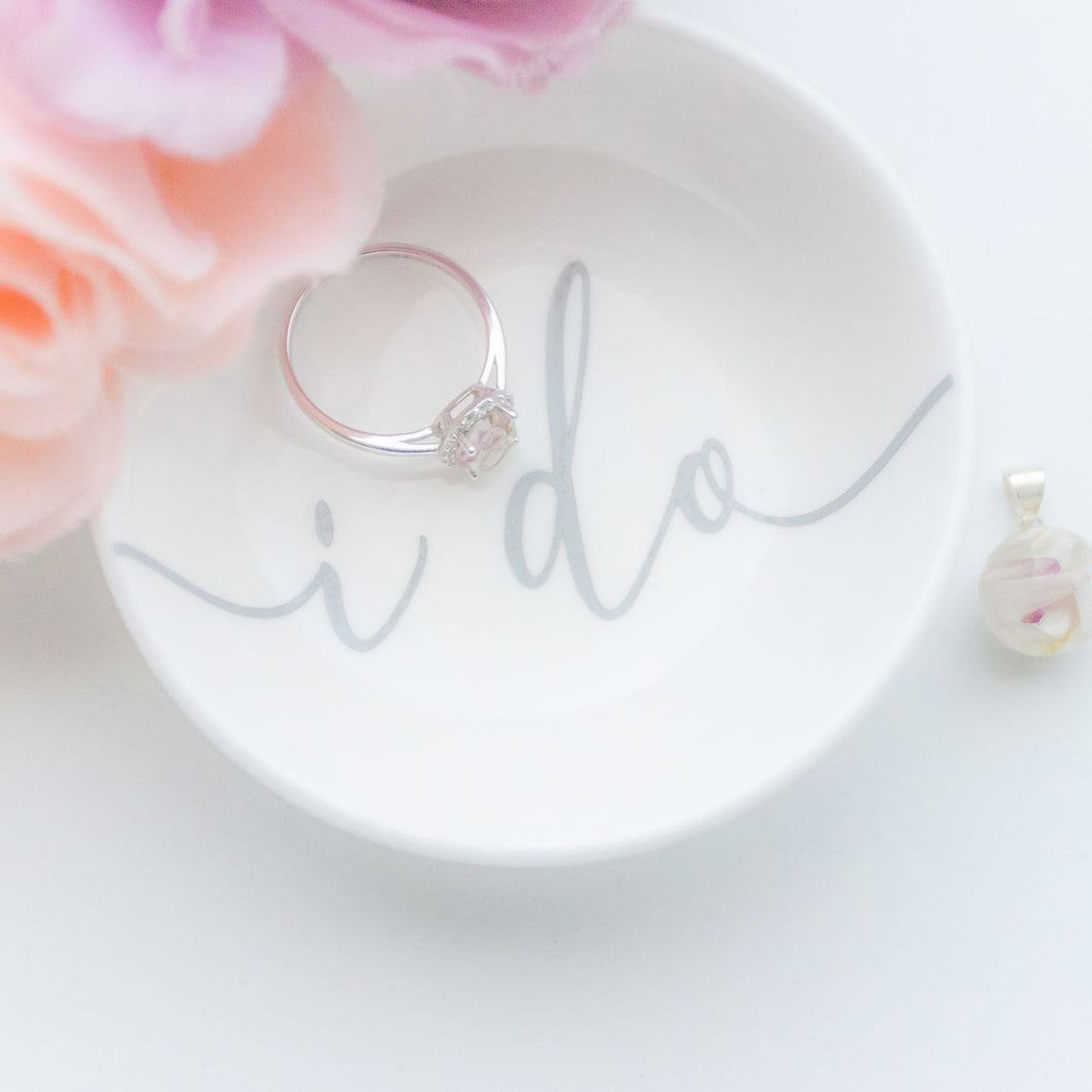 RubyBabyDesigns Keepsake Collective Personalised ring dish, simple yet stunning white ceramic ring dish featuring personalisation with name or word. Perfect for gifting or wedding. Text is grey on a white / off white dish. Personalised in Melbourne.
