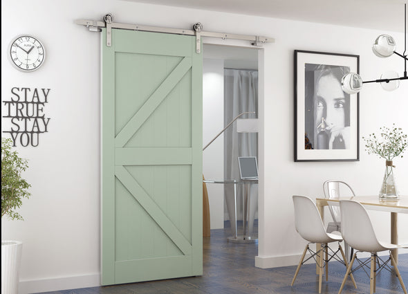 Stainless steel soft close barn door hardware, The Gears is mounted on a sage green K style door. Clean and fun styling.
