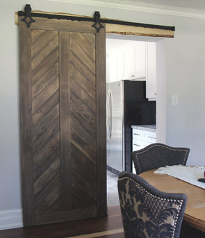 •	The Chevron barn door in weathered grey creates visual interest for your space. Shown with Ace soft close barn door hardware.
