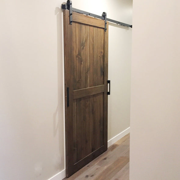 A divided door in Barn Board Brown with Big Wheel soft close barn door hardware