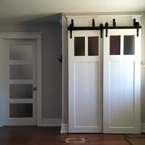 Bypass barn door hardware featuring soft close technology