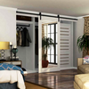 Soft close bent strap  barn door hardware with a modern feel