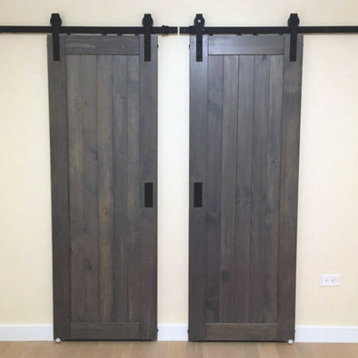 The clean simple lines of a ranch door can be rustic or modern, depending on their finish Here they cover closet and bathroom entrances.