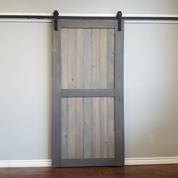 Bent Strap soft close barn door hardware on a Divided barn door, stained for the client in Weathered Grey.
