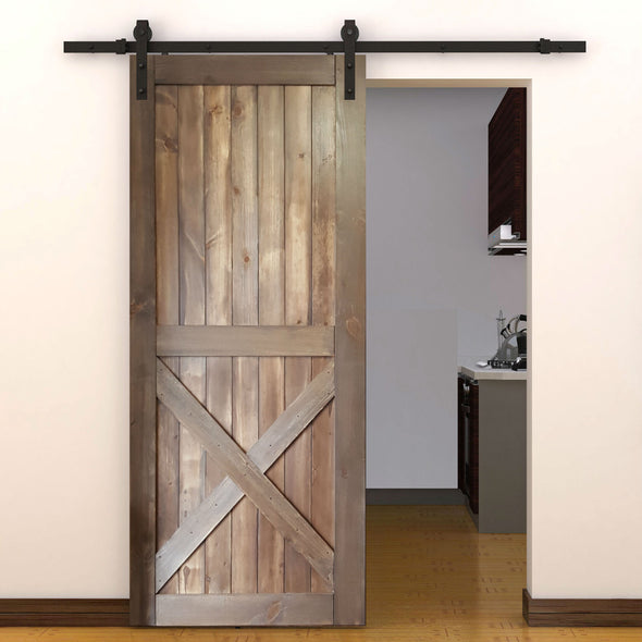 The Half X door in barn board brown with soft close barn door hardware.
