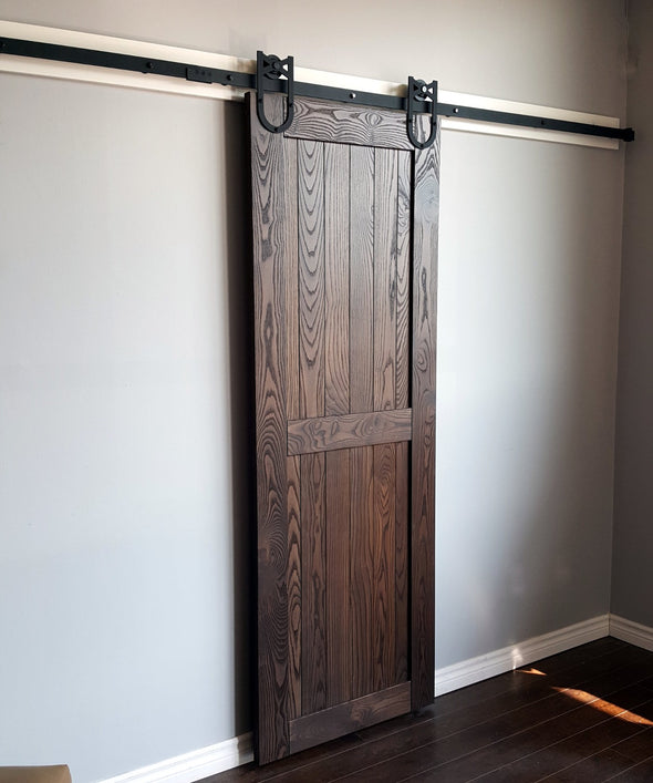 The hardwood farm door is a classic style in beautifully grained ash, shown here in black cherry stain.