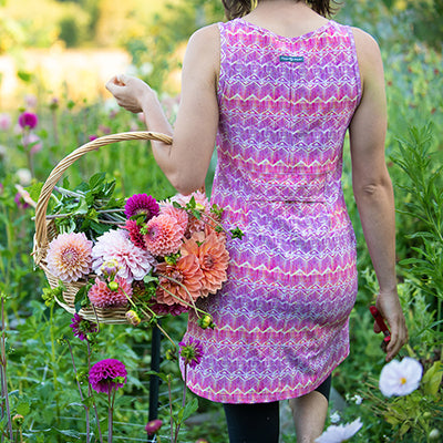 Girl in pink Electra dress with flowers