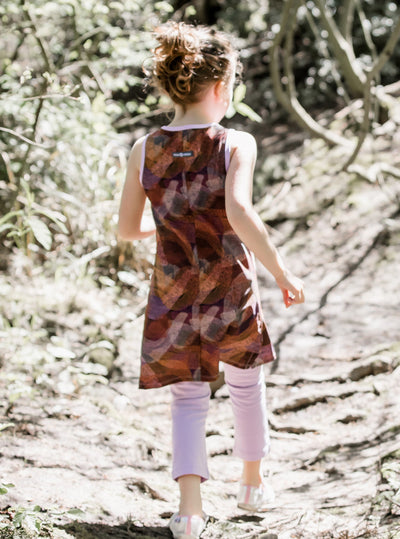 Rear view of young girl walking in Dune Bug Mini-Muu play dress, kids dress, running dress, party dress.