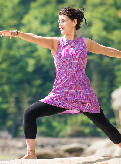 Woman doing yoga in Dynamite Nuu-Muu exercise dress, running dress, travel dress, athletic dress