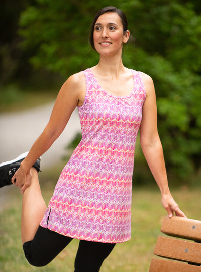 Woman stretching in Electra Nuu-Muu Scoop pocket exercise dress, running dress, travel dress, athletic dress