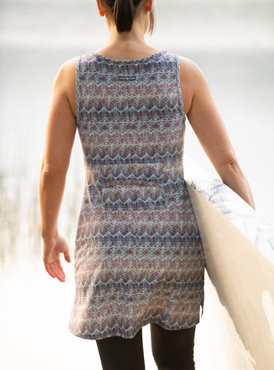 Rear view of woman carrying paddle board in Grace Nuu-Muu Scoop pocket exercise dress, running dress, travel dress, athletic dress
