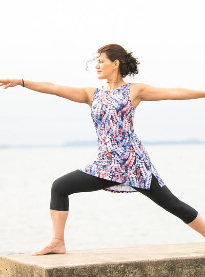 Woman doing yoga in Laurie Ruu-Muu pocket exercise dress, running dress, travel dress, athletic dress