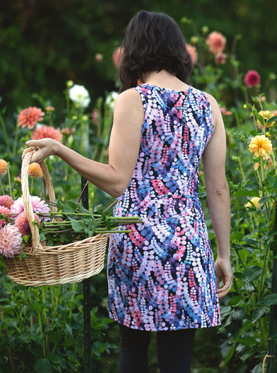 Rear view of woman carrying basket of flowers in Laurie Ruu-Muu pocket exercise dress, running dress, travel dress, athletic dress