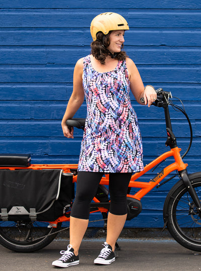 Woman standing with bicycle in Laurie Nuu-Muu Scoop pocket exercise dress, running dress, travel dress, athletic dress