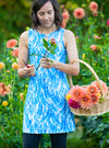 Woman gardening in Marilea Ruu-Muu pocket exercise dress, running dress, travel dress, athletic dress