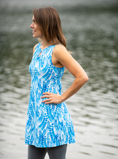 Side profile of woman standing in Marilea Ruu-Muu pocket exercise dress, running dress, travel dress, athletic dress