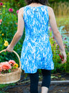 Rear view of woman gardening in Marilea Nuu-Muu Scoop pocket exercise dress, running dress, travel dress, athletic dress