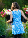 Rear view of woman carrying buckets of flowers in Marilea Ruu-Muu pocket exercise dress, running dress, travel dress, athletic dress