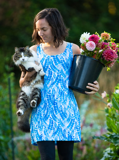 Woman carrying cat and bucket of flowers in Marilea Nuu-Muu Scoop pocket exercise dress, running dress, travel dress, athletic dress