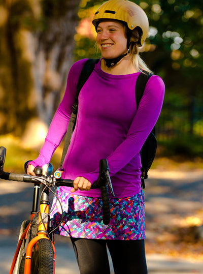 Woman wearing Plum Nuu-Tee over Nuu-Muu exercise dress, running dress, travel dress, athletic dress while biking