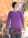 Woman wearing Plum Nuu-Tee over Nuu-Muu exercise dress, running dress, travel dress, athletic dress