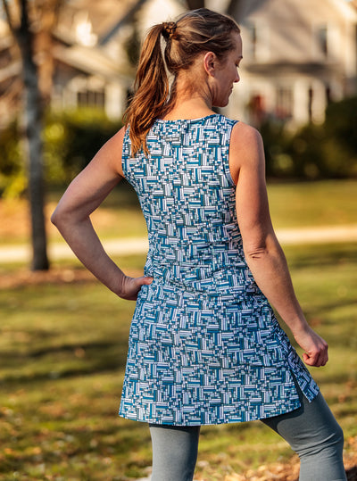 Rear view of woman standing in Puzzle Nuu-Muu Scoop pocket exercise dress, running dress, travel dress, athletic dress