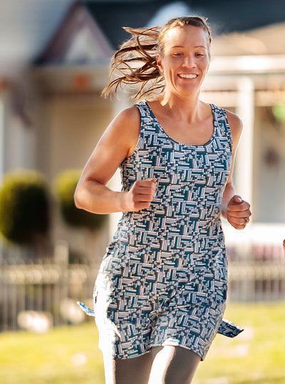 Woman running in Puzzle Nuu-Muu Scoop pocket exercise dress, running dress, travel dress, athletic dress