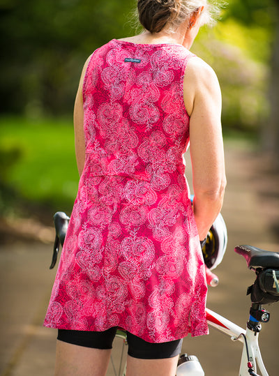 Rear view of woman standing with bicycle in Ruubarb Ruu-Muu pocket exercise dress, running dress, travel dress, athletic dress