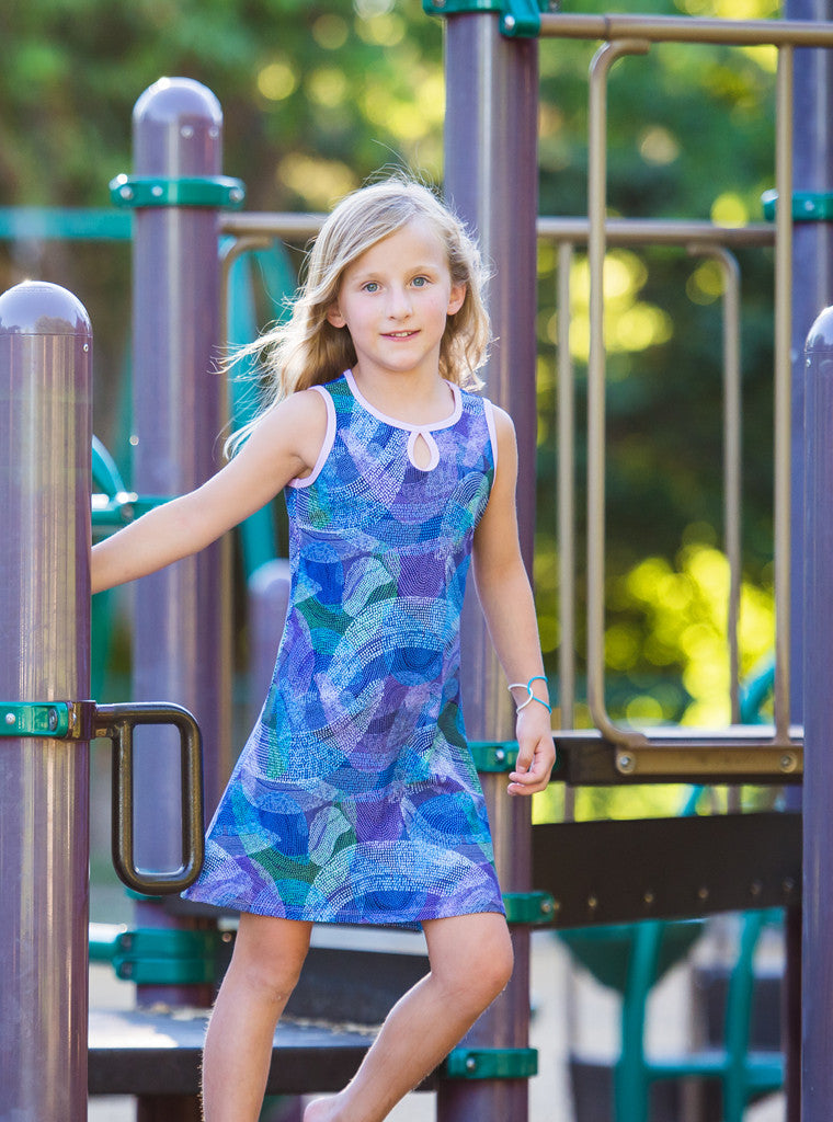 Young girl playing in Splash Mini-Muu play dress, kids dress, running dress, party dress.