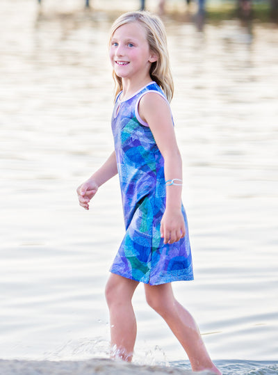 Young girl walking in Splash Mini-Muu play dress, kids dress, running dress, party dress.