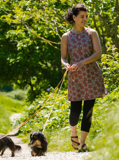 Woman walking dogs in Sundae Ruu-Muu pocket exercise dress, running dress, travel dress, athletic dress
