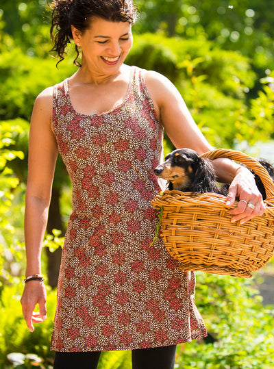Woman holding puppy in basket in Sundae Nuu-Muu Scoop pocket exercise dress, running dress, travel dress, athletic dress