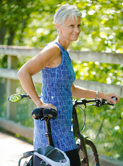 Woman standing with bicycle in Waterfall Ruu-Muu pocket exercise dress, running dress, travel dress, athletic dress