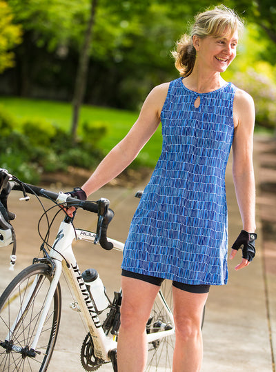 Woman standing with bicycle in Waterfall Nuu-Muu exercise dress, running dress, travel dress, athletic dress
