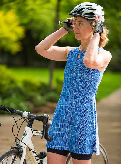 Woman adjusting bike helmet in Waterfall Ruu-Muu pocket exercise dress, running dress, travel dress, athletic dress