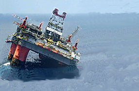 oil rig tilting and sinking in ocean