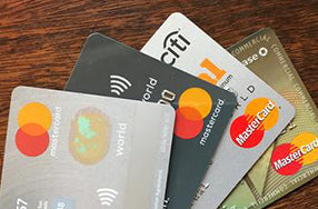 array of four mastercard cards