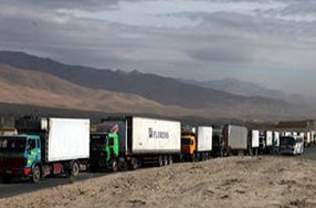 caravan of trucks in desert