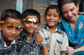 Three Indian children with caucasian woman all smiling