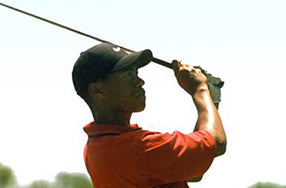 tiger woods from the side in backswing
