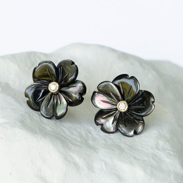 Grey flower mother of pearl diamond and 18carat gold stud fittings