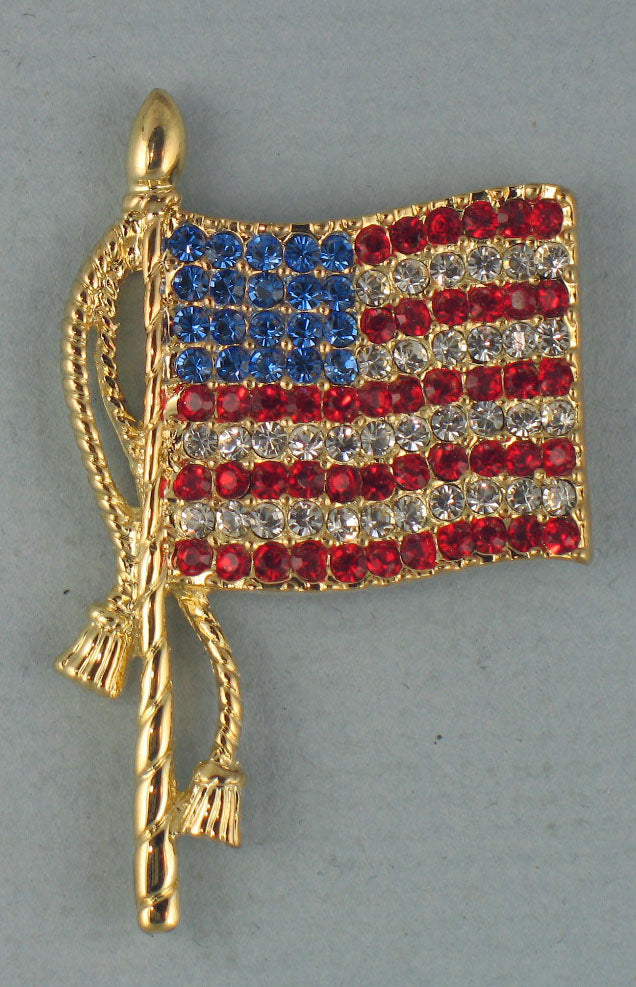 Flag brooch - gold with tassels