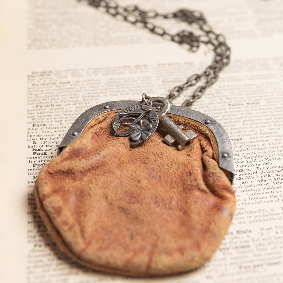 Assemblage necklace made of Antique Leather Coin Purse, Good Luck Horse Shoe and Clover Charm by Green House Supply GHS001